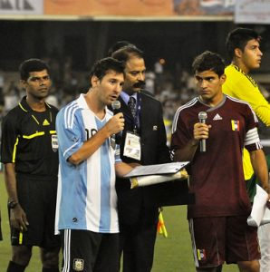 (Fig. Messi playing in Bengal in a match organized by Saradha)