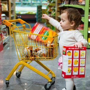 A little kid while shopping in a DMart Store | DMart Business Model
