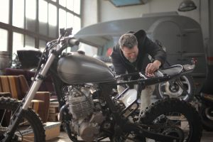 Man assembling his power bike | Best Two-Wheeler Stocks in India